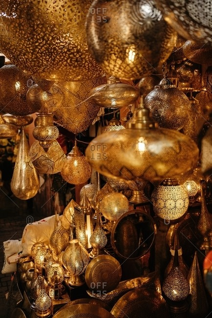 Closeup of various Moroccan traditional antique lanterns and lamps hanging on local market in Marrakesh city