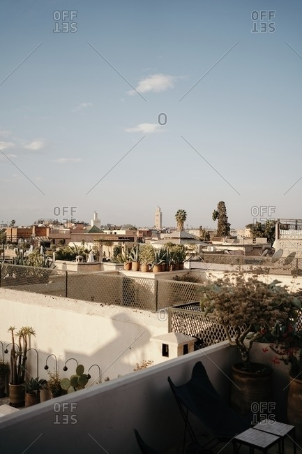 From above picturesque view of ancient city Marrakesh with typical stone houses in sunny day with blue sky on background