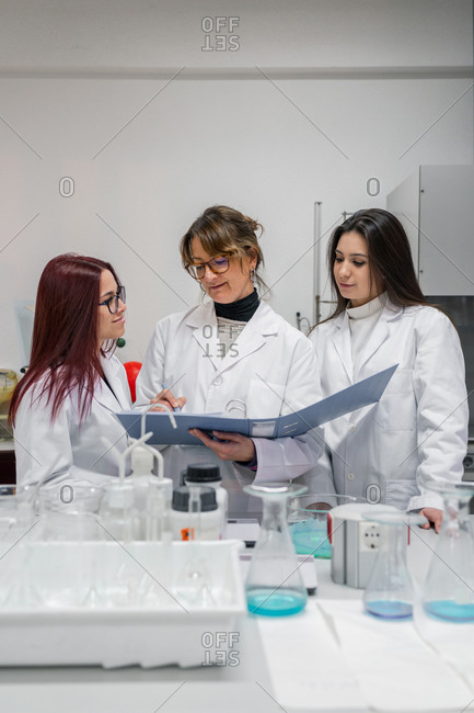 Female scientists making notes in lab