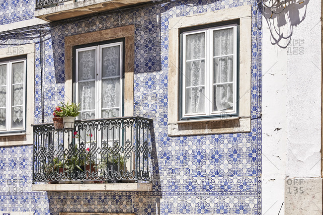 House with blue tile exterior and balcony in Lisbon, Portugal