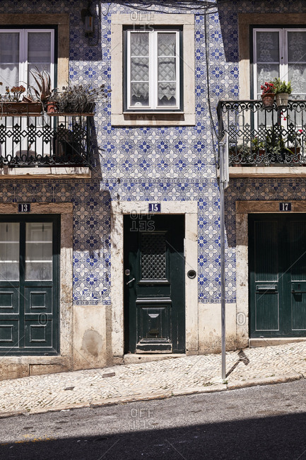Lisbon, Portugal - July 19, 2019: Apartment home on slanted street with blue tile exterior