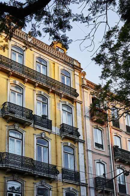 Yellow and pink apartment building in Lisbon, Portugal