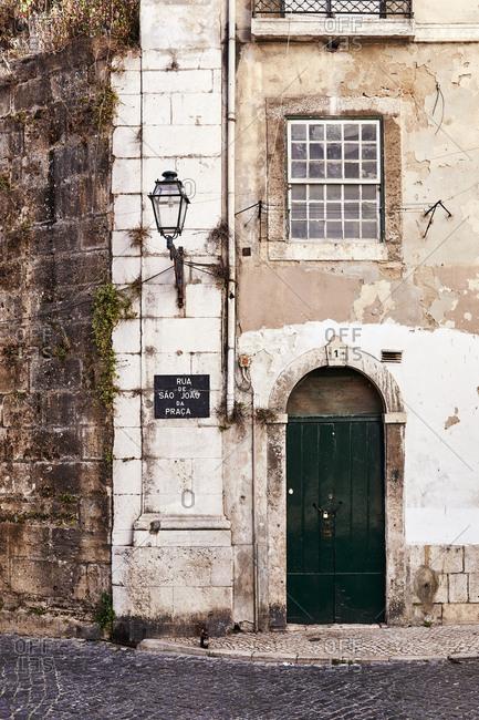 Lisbon, Portugal - July 20, 2019: Old building on cobblestone street