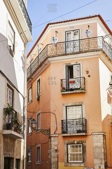 Lisbon, Portugal - July 20, 2019: Orange apartment building in downtown Lisbon