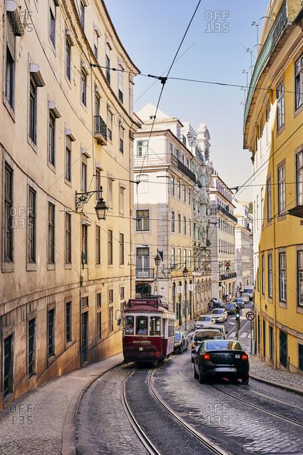 Lisbon, Portugal - July 20, 2019: Tram car trolley on cobblestone street