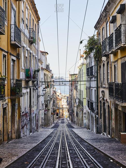 Lisbon, Portugal - July 21, 2019: Railway for tram cars on slanted street
