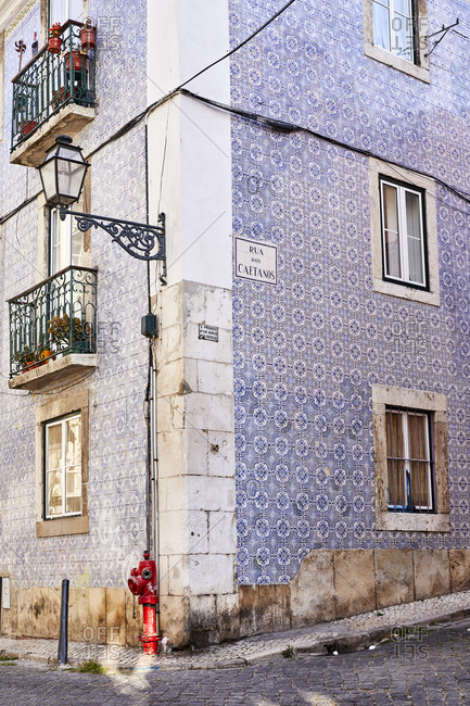 Lisbon, Portugal - July 21, 2019: Corner building with blue decorative tile