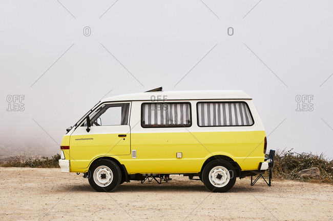 Portugal - July 23, 2019: Bright yellow retro camper van
