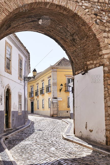 Old buildings alone a cobblestone street in a the Algarve region of Portugal