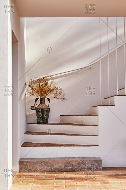 White steps with brick treads on decorative dried flower arrangement