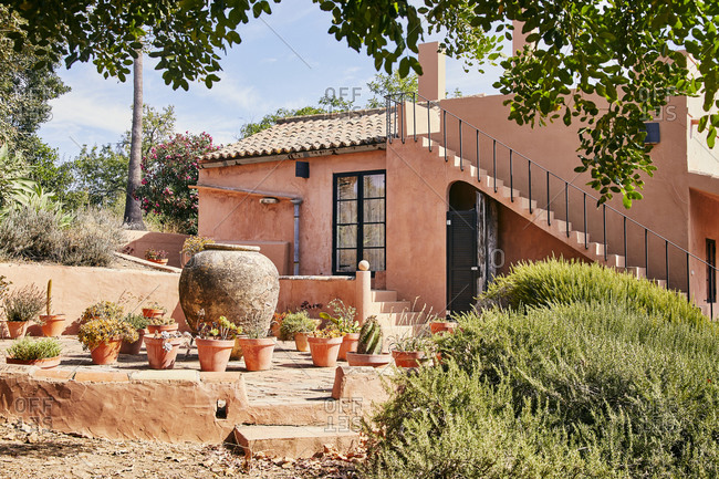 Home in rural Portugal with several terracotta planters
