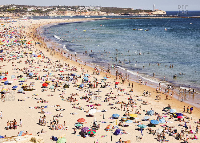 Portugal - July 28, 2019: Bird's eye view of a crowded beach on the coast of Portugal