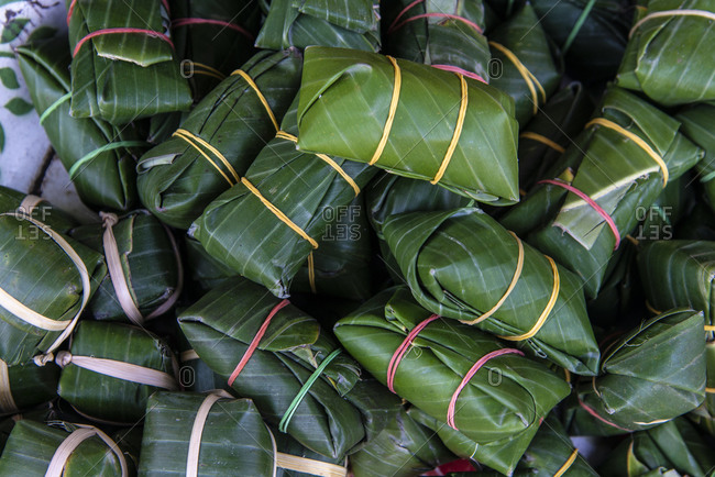 Packets of sticky rice for sale at a market in Luang Prabang, Laos