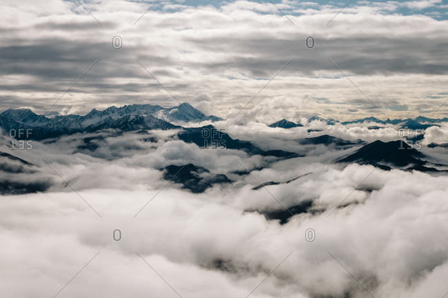 View over low lying clouds over mountains