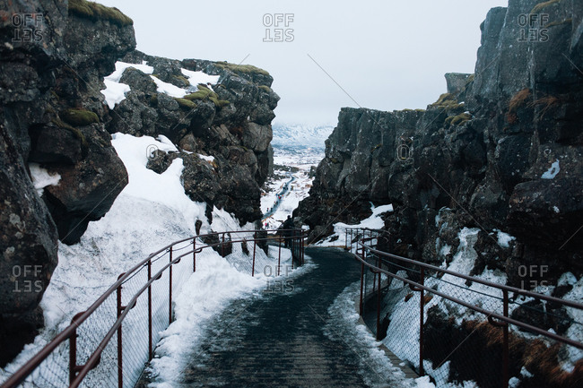 Path with railings on mountain in winter