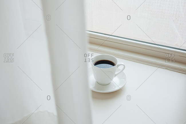 A cup of coffee by bright window