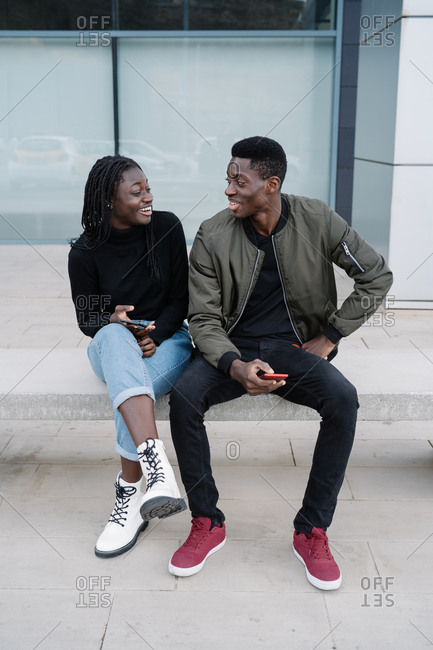 Young black couple meeting on city street