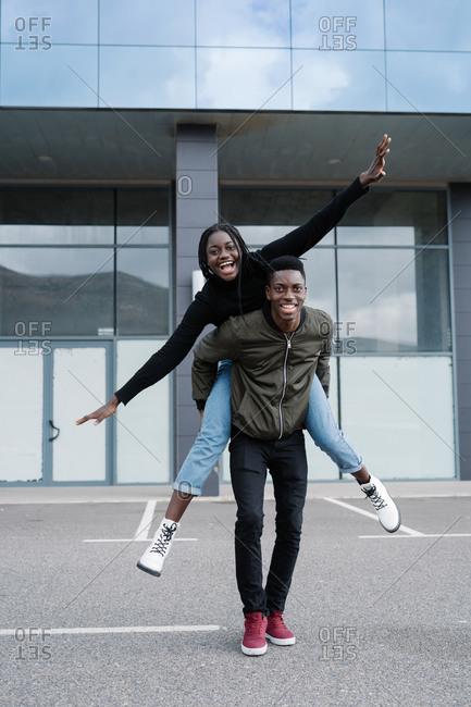 Black couple having fun on street