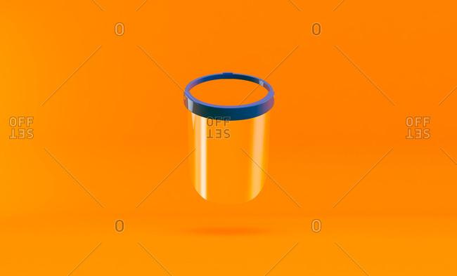 Protective mask for Coronavirus pandemic on orange background