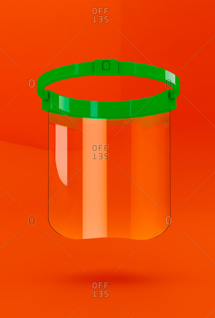 Transparent protective mask for the Coronavirus pandemic on orange background