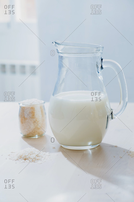 Jar of milk and rice on table