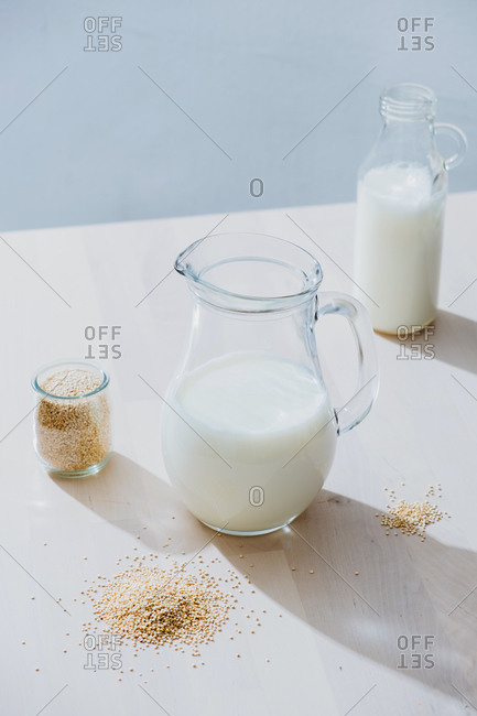 Jar of milk and oatmeal on table