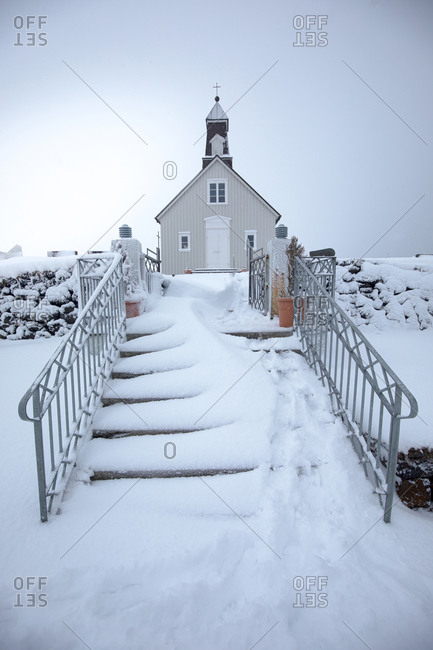 Small church on snowy terrain