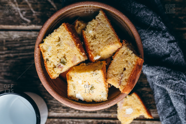 Homemade corn bread on rustic wood