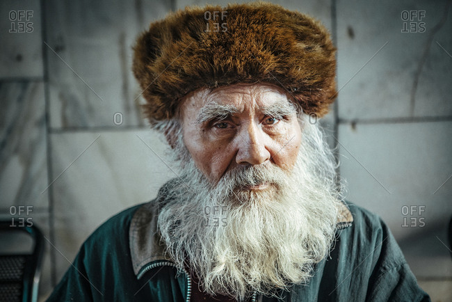 Old man with beard at the railway station in Irkutsk, Russia
