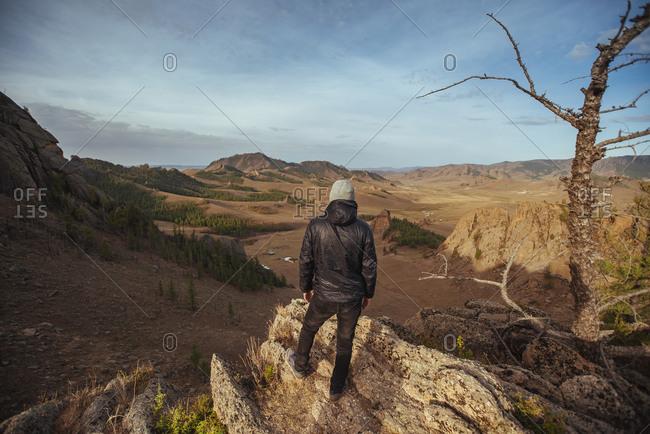 Man standing on rocks, Mongolian Switzerland, Gobi Desert, Mongolia