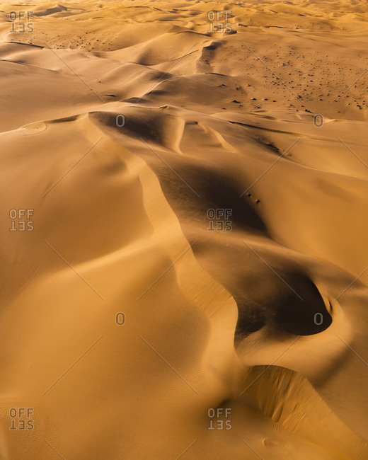 Flight over dunes of Sossusvlei at sunset, Namibia, Africa