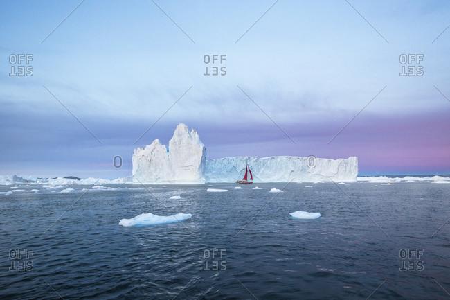 January 1, 1970: Icebergs and sailboat in Disko Bay on Midsummer, Greenland