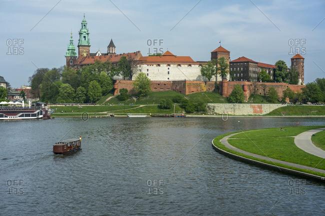 April 23, 2018: Wawel Castle at the Vistula river, Krakow, Poland