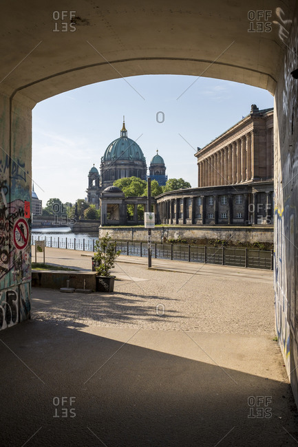 May 14, 2018: Underpass between Monbijou-Park and James-Simon-Park, Spree, at the back Museum Island with Berlin Cathedral, Mitte, Berlin