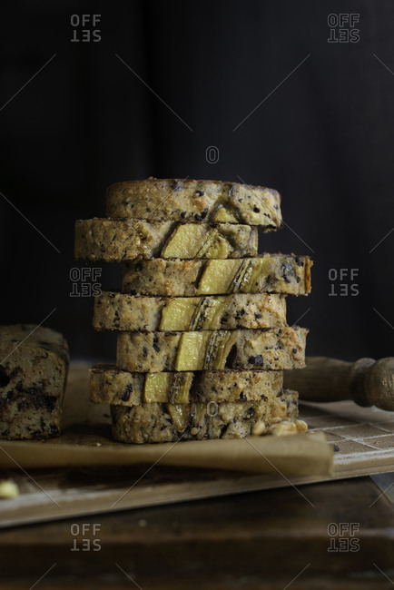 Vertical slices of Banana bread with Chocolate chips and walnut on baking paper