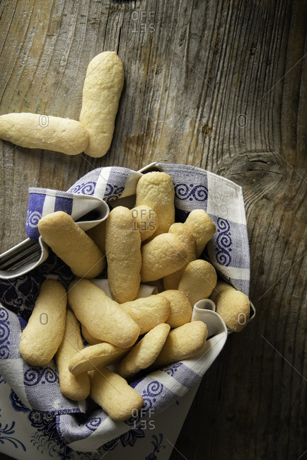Homemade ladyfingers in a vintage metal box on a wooden background