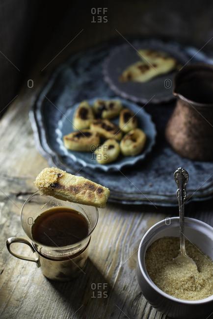 Tunisian semolina rolls getting eaten  with sugar and Turkish coffee