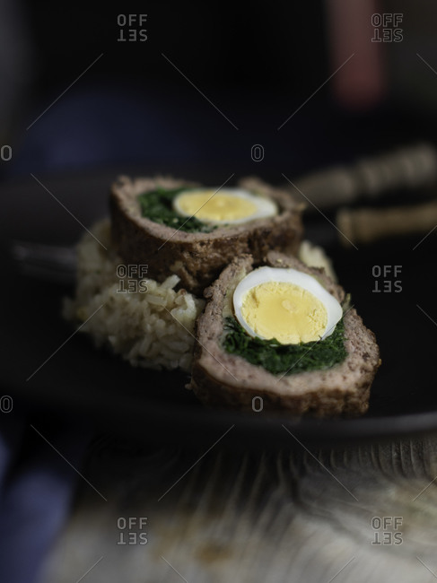 Traditional Tunisian meat rolls called ain sbanioura (spanish eye) on rice filled with eggs and spinach