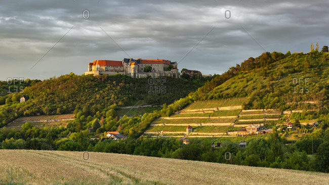 June 12, 2019: View of Neuenburg Castle and the ducal vineyard, thunderstorm atmosphere, evening light, Freyburg (Unstrut), Saxony-Anhalt, Germany