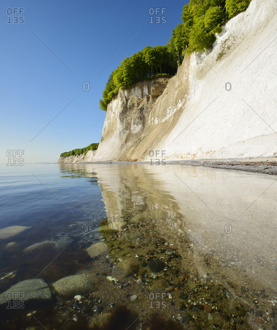 Germany, Mecklenburg-Western Pomerania, Rugen Island, Jasmund National Park, chalk cliffs reflected in the waters of the Baltic Sea