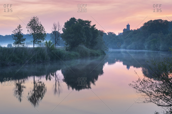 Sunrise at the Saale river with ruins of the Schonburg, water reflection, morning fog, Naumburg, Saxony-Anhalt, Germany