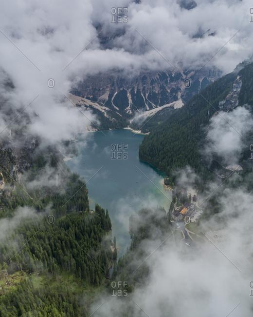 Pragser wild lake in the fog, South Tyrol, Italy
