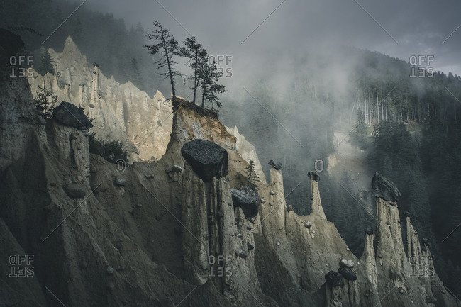 Earth pyramids in the mist, South Tyrol, Italy