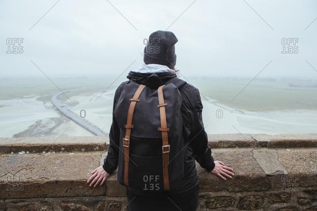 Backview of traveler in Mont Saint-Michel, France