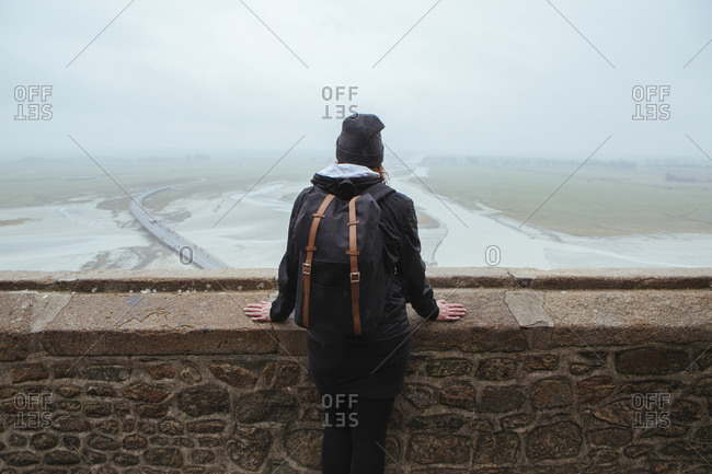 Traveler looking out in Mont Saint-Michel, France