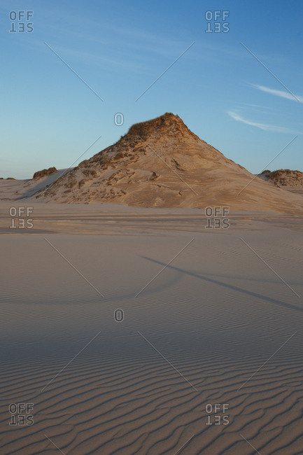 Sand dune against blue sky, Leba, Poland