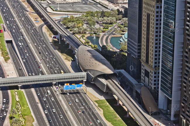 January 1, 1970: Metro Station and Highway Sheikh Zayed Road in Dubai, edged by skyscrapers, Dubai, United Arab Emirates