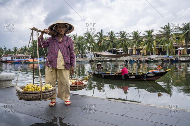 September 25, 2019: Street vendor selling goods, Hoi An, Vietnam