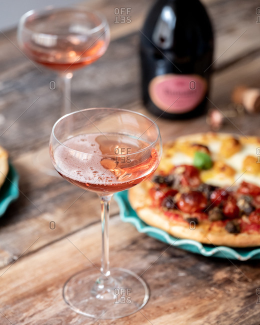Small homemade pizzas served with champagne