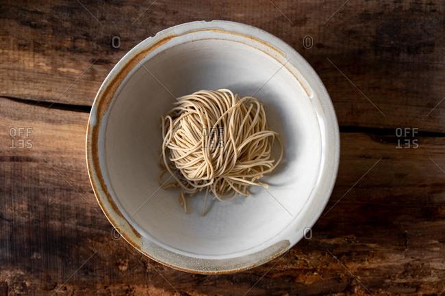 Raw ramen noodles in a bowl